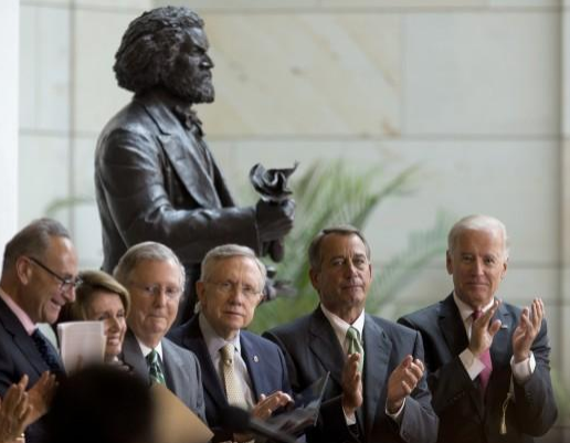Biden uses tribute in Capitol for abolitionist Frederick Douglass to pitch DC voting rights